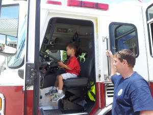 vb fire station - ethan riding the truck